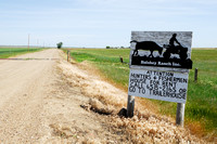 Road sign near American Prairie Reserve attention hunters & fishermen, house for rent, near Sun Prairie, Montana, USA