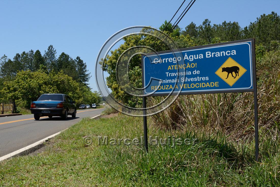 Wildlife warning sign for maned wolf, southern stream crossing (Córrego Água Branca), Itirapina Ecological Reserve, São Paulo, Brazil