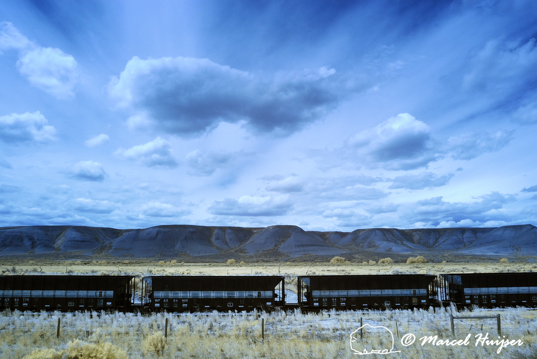 Railroad cars near Bridger, Montana, USA. In super color infrared, R and B channels switched