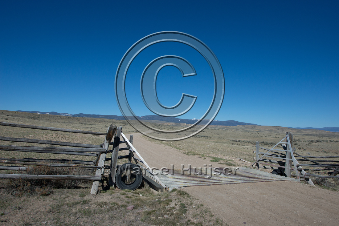 Cattle guard on gravel road, Montana, USA