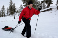 Marcel Huijser pulls cargo sled on cross country skis, Wyoming, USA
