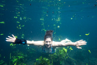 Bethanie Walder swims in a cenote, Yucatán, Mexico
