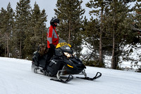 Guide leading a line of snowmobiles, near West Yellowstone, Yellowstone National Park, Wyoming, USA