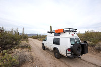 Camper van on dirt road, Saguaro National Park, Arizona, USA