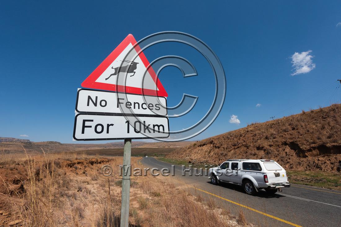 Wildlife warning sign, no fences, for 10 km, Golden Gate Highlan