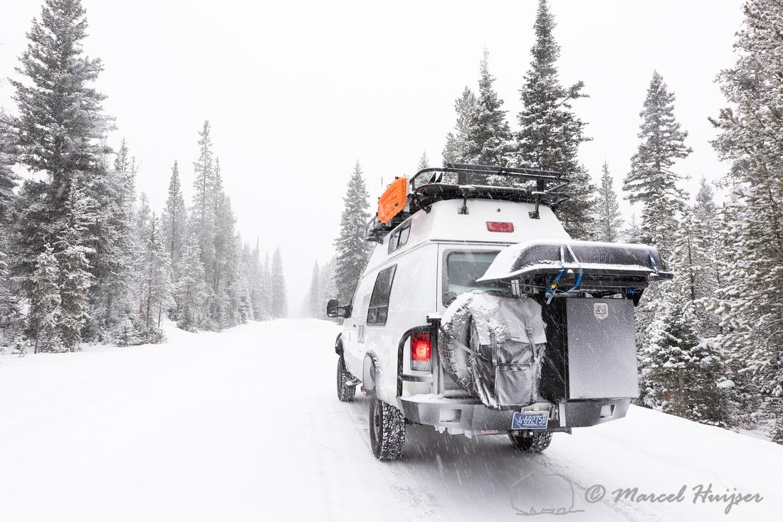 Camper van in snow storm, Wyoming