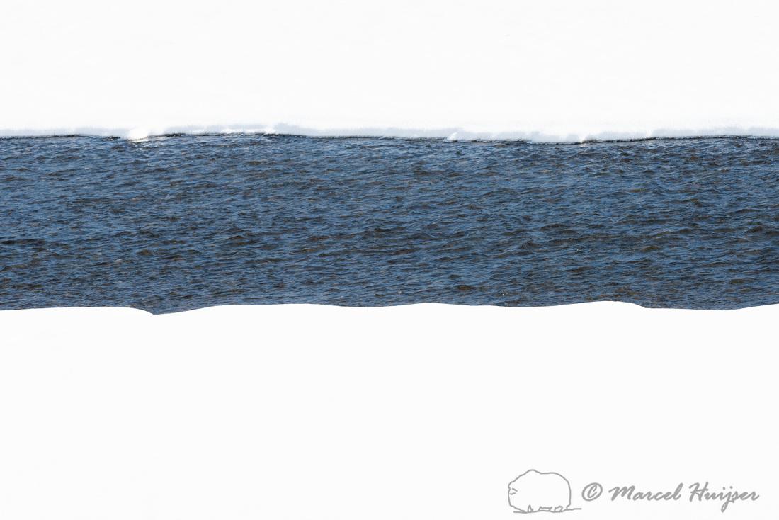 A river runs through it, Wyoming, USA. River through snow field.