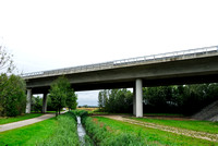 Farm road, ditch and bike pedestrian pathway, multifunctional underpass, across A4 motorway, Parndorf, Austria.