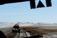 Dirt road and vehicle in winter near Omnodelger, Khentii, Mongolia