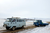 Helping another vehicle get out of a snow bank, near Bayan-Adarga, Khentii, Mongolia