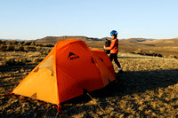 Emiliano Ferguson setting up camp near a sage grouse (Centrocercus urophasianus) lek, Montana, USA