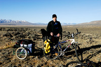 Marcel Huijser and his bicycle and trailer packed with photo and camping gear near a sage grouse (Centrocercus urophasianus) lek, Montana, USA