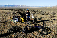 Emiliano Ferguson with bicycles and trailer packed with photo and camping gear near a sage grouse (Centrocercus urophasianus) lek, Montana, USA