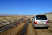 Car on dirt road (parallel two tracks) just north of Khustain Nuruu National Park, Mongolia