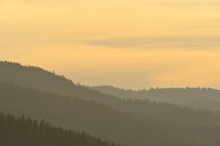 Forested ridges at sunset, west of Missoula, Montana, USA