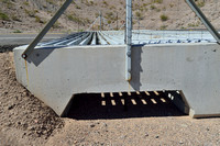 Combined drainage and escape for small animals under wildlife guard, Arizona, USA