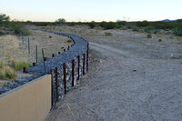 Approach of gabion wall to culvert to protect against erosion from flashfloods, Arizona, USA