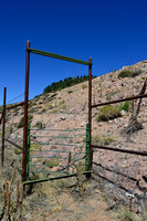 A one-way gate designed to allow wildlife to escape from the fenced road corridor, Arizona, USA