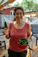 Bethanie Walder and freshley harvested jalapeño peppers from our greenhouse, Missoula, Montana, USA