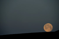 Oops... full moon rolling down the hill, near Bannack, Montana, USA