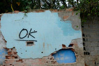 OK sign indicates the property in the favela (slums) has been purchased and can be demolished to make way for the new motorway, Greater São Paulo, Brazil