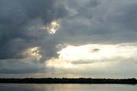 Sun shining through clouds in evening, Horicon Marsh National Wildlife Refuge, Wisconsin, USA