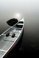 Canoe in mist, Boundary Waters, Minnesota, USA