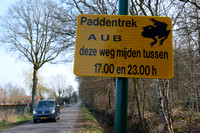 Wildlife warning sign, Voluntary road closure at night between 5 and 11 pm during spring migration of common toads (Bufo bufo), Soest, The Netherlands