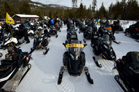 Lines of snowmobiles at Madison junction parking area, Yellowstone National Park, Wyoming, USA