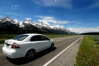 Car with Grand Tetons, Teton Park Rd, Grand Teton National Park, WY