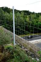 Wildlife fence on top of multifunctional overpass (about 23 m wide), across A4 motorway, Parndorf, Austria