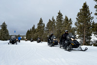 Line of snowmobiles, near West Yellowstone, Yellowstone National Park, Wyoming, USA