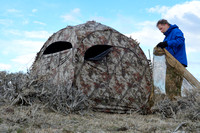 Marcel Huijser sets up his blind and approach screens near a sage grouse lek, Montana, USA