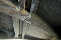 Bats roost in these cracks between concrete elements under a bridge, California, USA