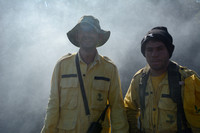 Fire fighters after putting out a grassland fire, Parque Nacional da Serra da Bocaina, São Paulo, Brazil