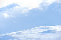 Clouds over snowy landscape, Dovrefjell National Park, Norway
