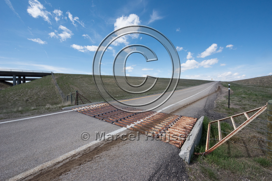 Cattle guard at on ramp at Reno road interchange along I-25, mil