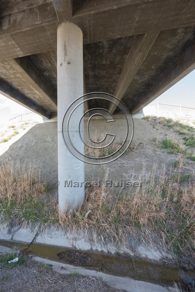 Bridge (Reno road interchange) along I-25, mile 265.48), north o