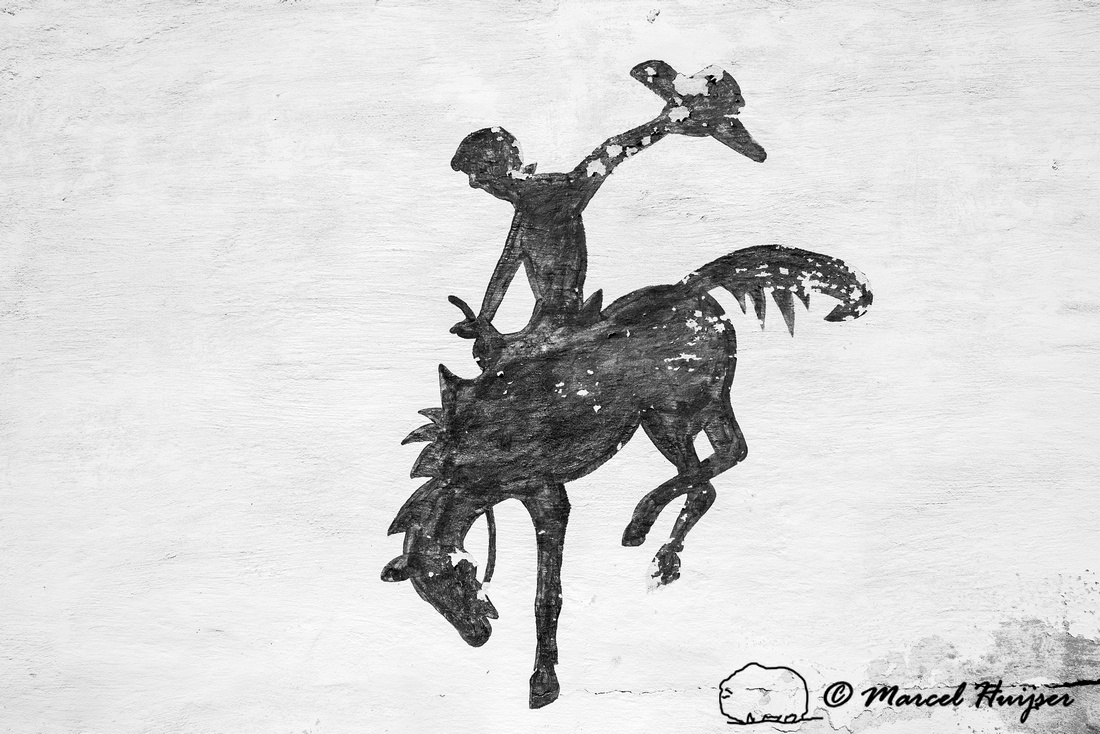 Bucking horse and rider logo, mural in a small town, Wyoming, US