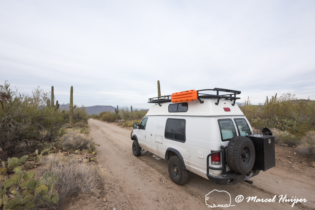 Camper van on dirt road, Saguaro National Park, Arizona, USA