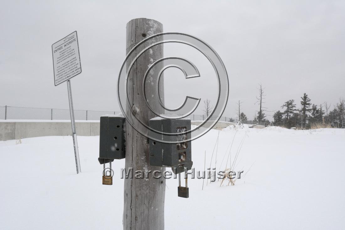 No tresspassing sign and wildlife cameras at wildlife overpass, Hwy 69, Ontario, Canada