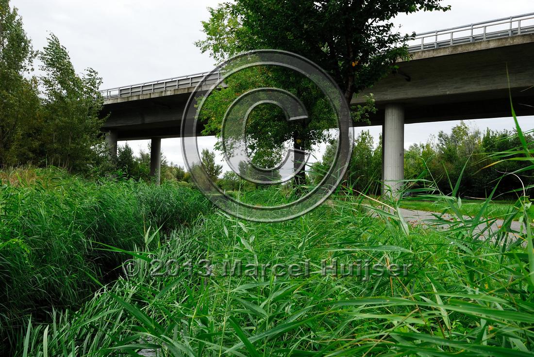 Farm road, ditch and bike pedestrian pathway, multifunctional underpass, across A4 motorway, Parndorf, Austria.