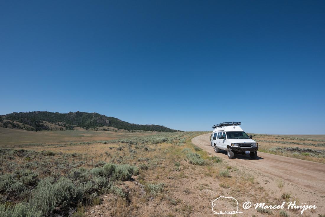 Our camper van on dirt road, Wind River Range,  Wyoming, USA