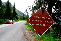 Road sign. Please do not discard food waste onto roadside, Montana, USA