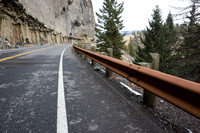 Weathered steel guard rail and fallen rock on closed highway, Ye