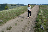 Hiker on path delineated with rocks, Waterworks Hill, Missoula, Montana, USA