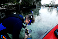 Checking the underwater bag for my camera before photographing the manatees at Crystal River, Florida, USA