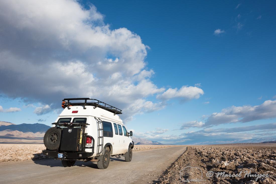 Camper van on dirt road, Devil's golf course, Death Valley Natio