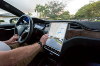 Ronald Blank in his Tesla Model S, Ft Lauderdale, Florida, USA