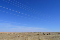 Power lines with markers for birds to reduce bird strikes, between Hanbogd and Oyu Tolgoi, near Hanbogd, Ömnögovi, Mongolia